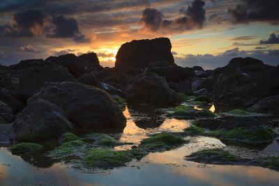 The Sunset Behind Tidal Boulders on Indian Beach Near Cannon Beach in Ecola State Park Oregon