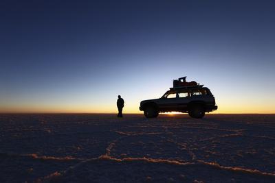 Toyota Land Cruiser Silhouetted Against Sunrise, Salar De Uyuni, Bolivia