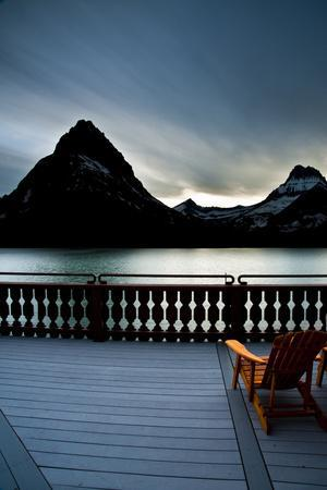 Glacier, Montana: Chairs Line the Deck of the Many Glacier Lodge During Sunset