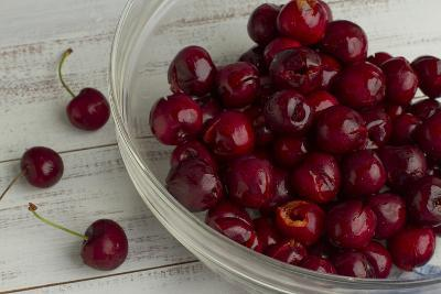 Fresh, Pitted Red Cherries in a Glass Bowl