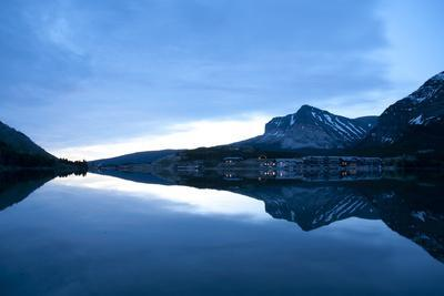 Glacier, Montana: Many Glacier Lodge Reflects Off of Swifcurrent Lake During Sunrise