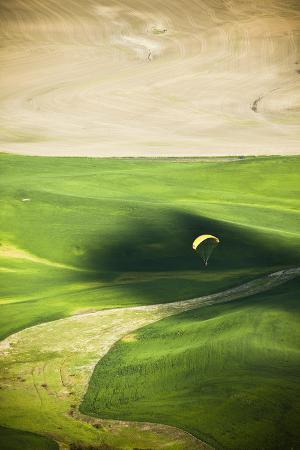 A Male Paraglider Prepares to Land in Palouse in Eastern Washington