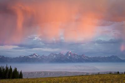 Sunrise Illuminates a Rain Shower Above a Smoke-Covered Jackson Hole, Wyoming