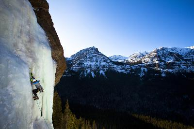 A Male Ice Climber Climbs over Easy (Wi3) in Hyalite Canyon in Montana