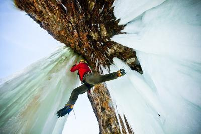 A Male Ice Climber Solos as He Stems Between Ice Columns at Banks Lake in Central Washington
