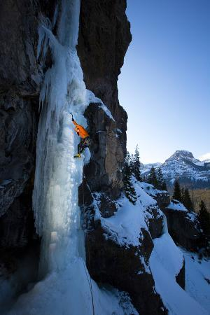 A Male Ice Climber Climbs the Scepter, a Hyalite Canyon Classic, During a Bluebird Day in Montana