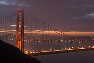 Golden Gate Bridge at Dawn with San Francisco City Lights in the Background