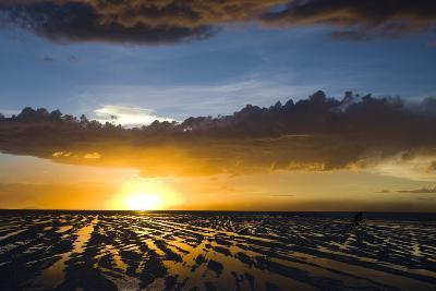 A Sunset Is Reflected in the Flood Waters of the Salar De Uyuni in Potosi, Bolivia