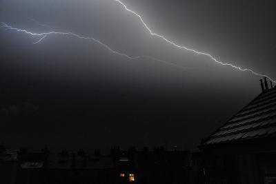 A Lightning Illuminates the Sky over Prague's Roofs