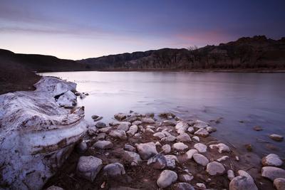 The Green River Flows Through Dinosaur National Monument, Utah as Snow Melts on Shores