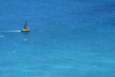 Small Yacht Sailing in Open Ocean Near Hawaii