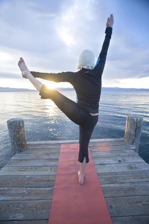 Young Woman Doing Yoga on Pier in Tahoe City, California