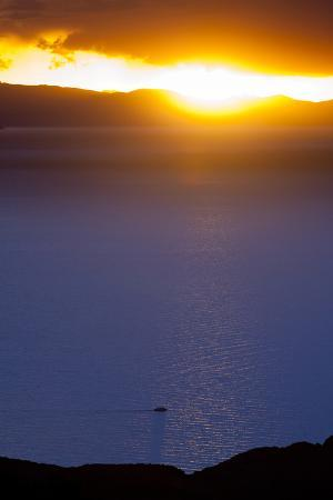 The Bolivian Side of Lake Titicaca and the Setting Sun after a Rainstorm in the Andes