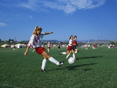 15 Year Old Girls in Action Durring Soccer Game, Lakewood, Colorado, USA