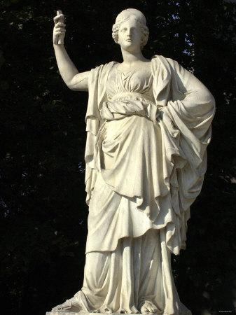 Statue of the Goddess Athena in a Garden of the Palace of Versailles, France
