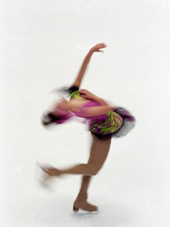 Blured Action of Female Figure Skater Preforming a Spin