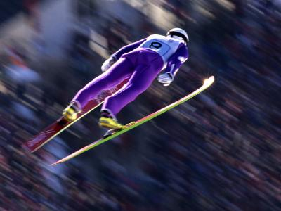 Blurred Action of Ski Jumper Flying Throught the Air