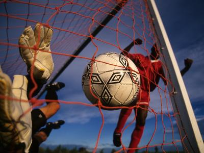 Soccer Player Scoring a Goal