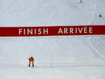 Skiier Arrives at the Finish Line