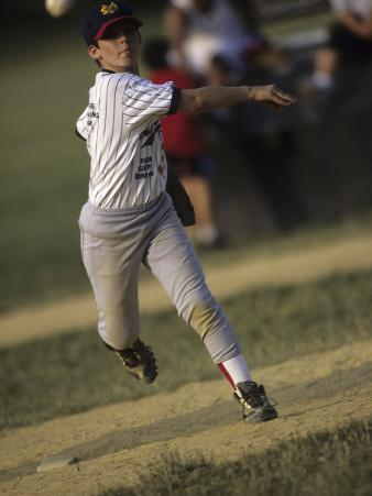Young Boy Pitching During a Little League Baseball Games