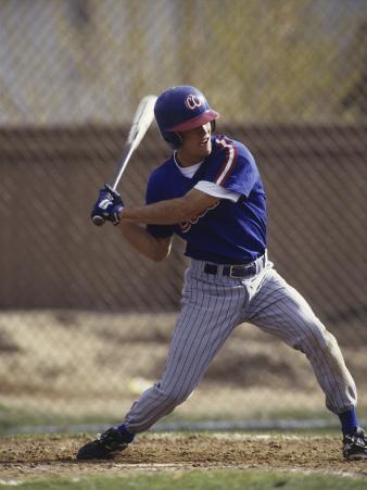 Baseball Player in Action Batting