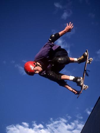 Male Skaeboarder Flys over the Vert, Boulder, Colorado, USA