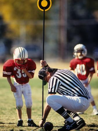 Referee Measuring for a First Down During a During a Pee Wee Football