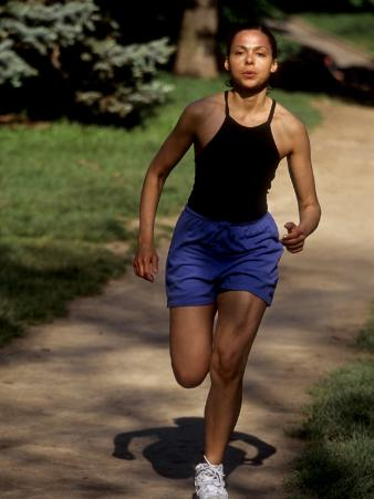 Hispanic Woman Running for Exercise, New York, New York, USA