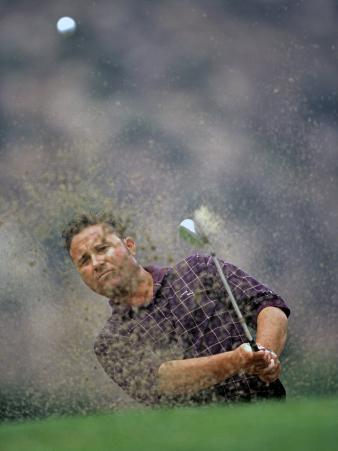 Golfer Blasting a Shot Out of a Sand Trap, San Diego, California, USA