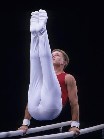 Male Gymnast Performing on the Parallel Bars