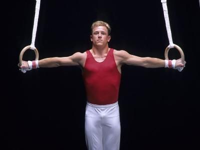 Male Gymnast Performing on the Rings