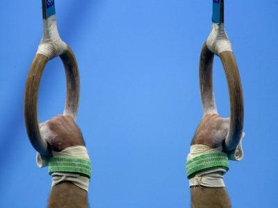 Detail of Male Gymnast Competing on the Rings, Athens, Greece