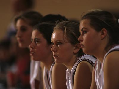 Teenage Girls Basketball Team Watching the Game from the Bench