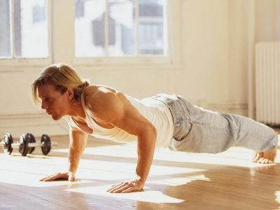 Young Man Preforming Push Up Exercise in Gym, New York, New York, USA
