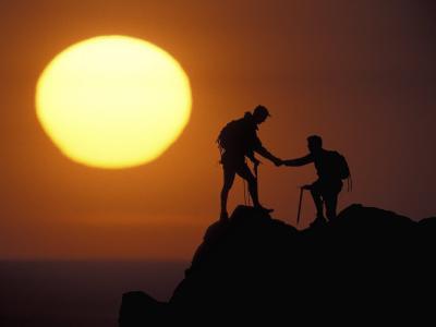 Two Climbers Reach the Summit at Sunrise, Colorado, USA