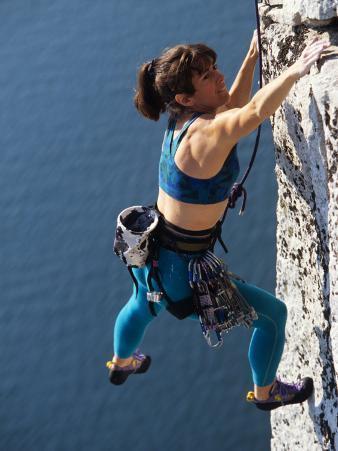 Female Rock Climber Reaching for a Grip, New Paltz, New York, USA