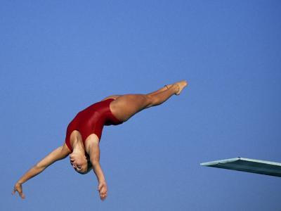 Women Diver Flying Through the Air