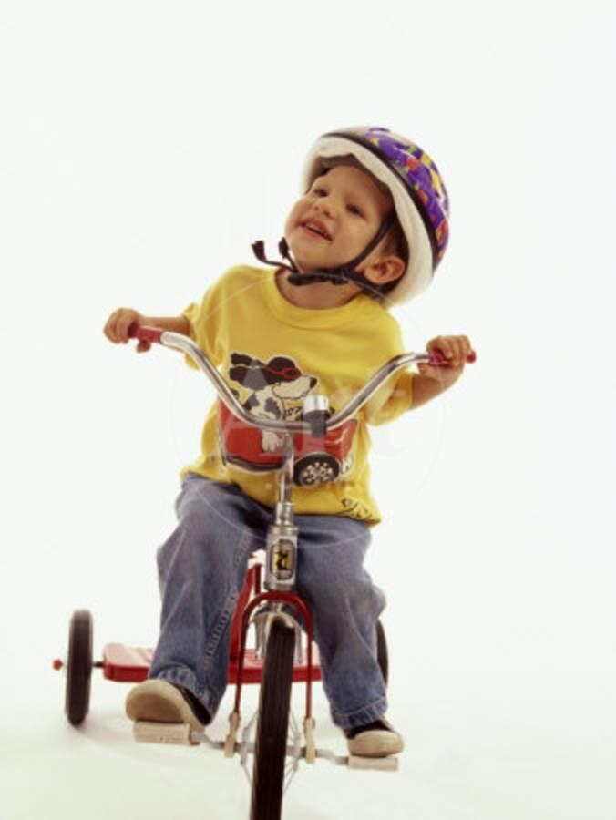 4 Year Old Boy Posing on His Tricycle, New York, New York, USA