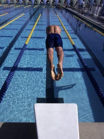 Swimmer Diving Off the Starting Blocks to Begin a Race