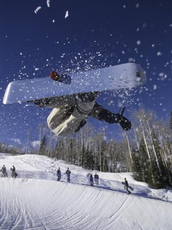Blurred Action of Snowboarder, Aspen, Colorado, USA