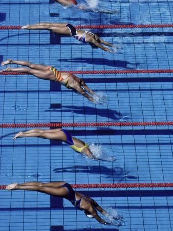 Female Swimmers at the Start of a Race