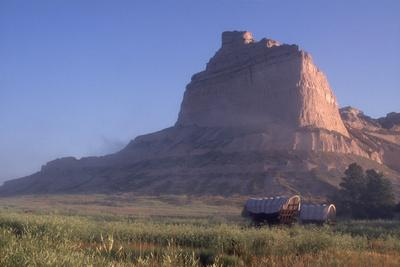 Covered Wagons on the Oregon Trail at Scotts Bluff, Nebraska, at Sunrise