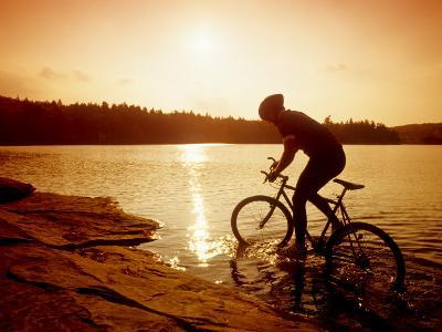 Silhouette of Mountain Biker at Sunset