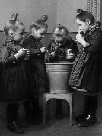 Little Girls Brushing their Teeth
