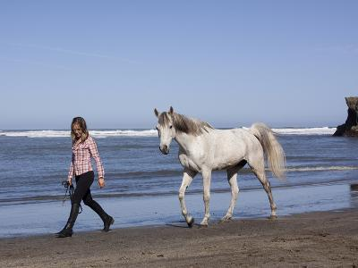 Horse and Lady Walking on Beach (Photo Released), California