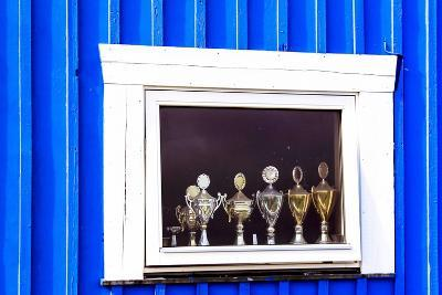 Window Display with Football Cups in a House of the Village Ilulissat, Greenland