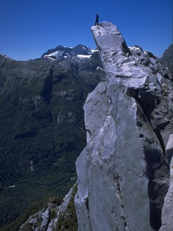 Climber on the Summit of a Rock Tower, Chile