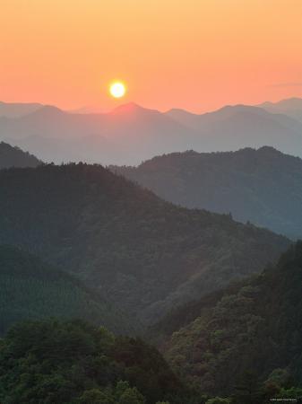 Sunset Beyond Mountains