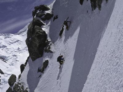 Climbing up a Steep Snow Face, New Zealand