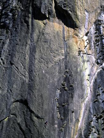 Climber Perched on Large Rock Wall, Madagascar